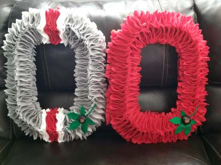 OSU Light Grey with red and white helmet stripe and OSU all red wreaths.