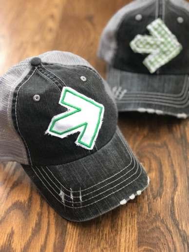 Shelly Lou's Lids Pelotonia hats; two green arrow styles.